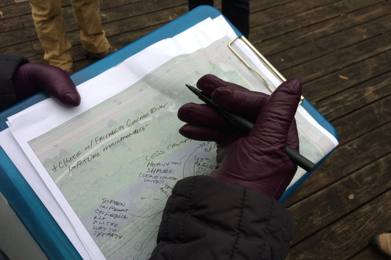 Landscape architect takes notes on work site